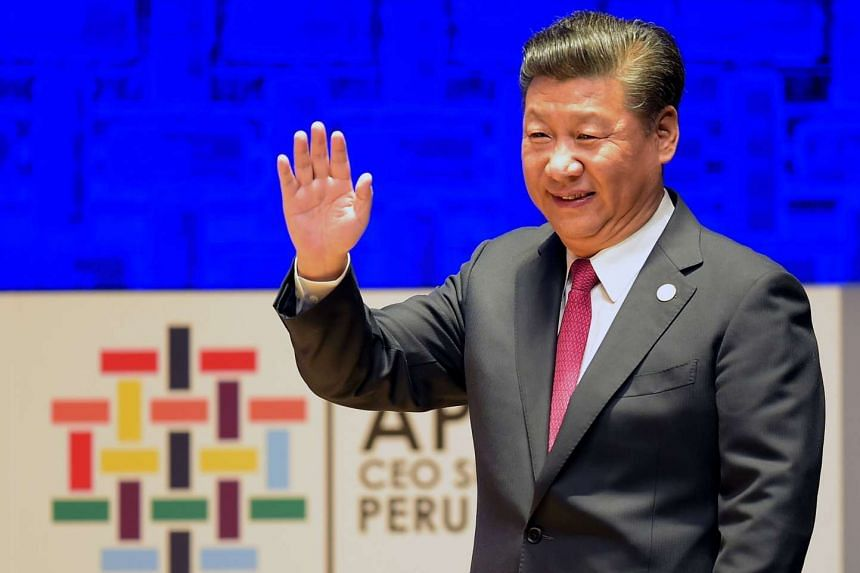 Xi Jinping waves as he prepares to speak at a session of the Apec CEO Summit, part of the broader Apec Summit in Lima.