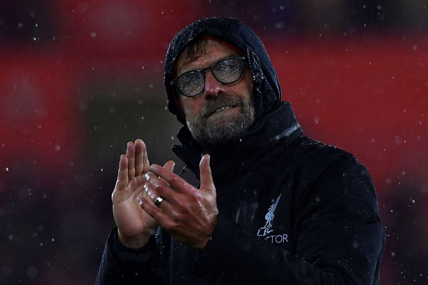 Rain covers the glasses of Liverpool's German manager Jurgen Klopp as he applauds the fans after the match.