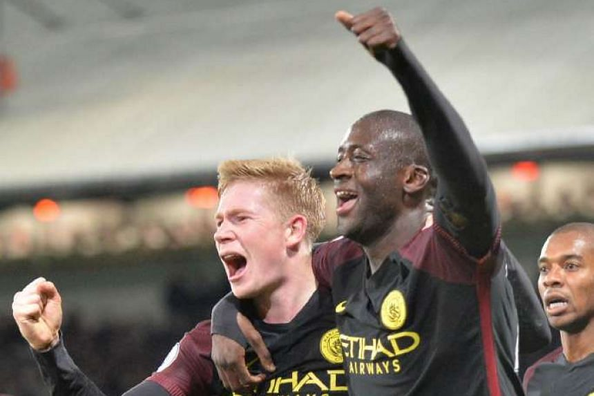 Manchester City's Ivorian midfielder Yaya Toure (R) celebrates with Manchester City's Belgian midfielder Kevin De Bruyne after scoring their second goal.