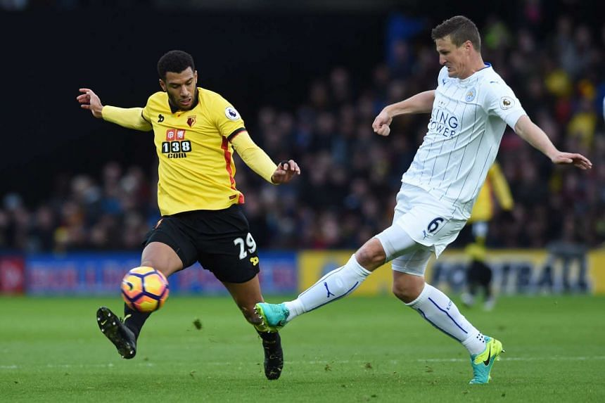 Watford's Etienne Capoue in action with Leicester City's Robert Huth.