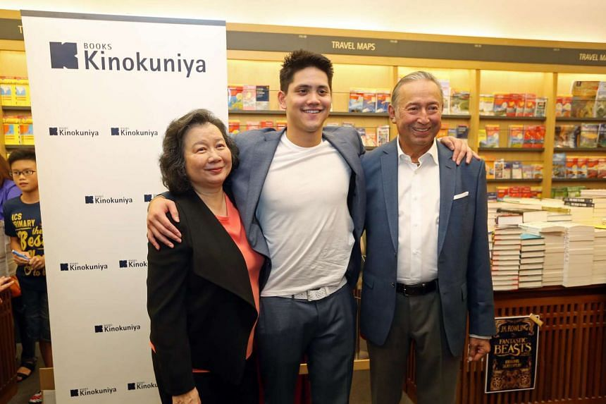 Joseph Schooling, with his parents Colin and May, at a book signing session for the photobook Hello, My Name Is Joseph Schooling at Kinokuniya, Ngee Ann City on Nov 20, 2016.
