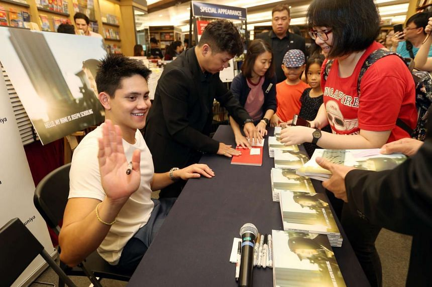 Joseph Schooling at a book signing session for the photobook Hello, My Name Is Joseph Schooling at Kinokuniya, Ngee Ann City on Nov 20, 2016.