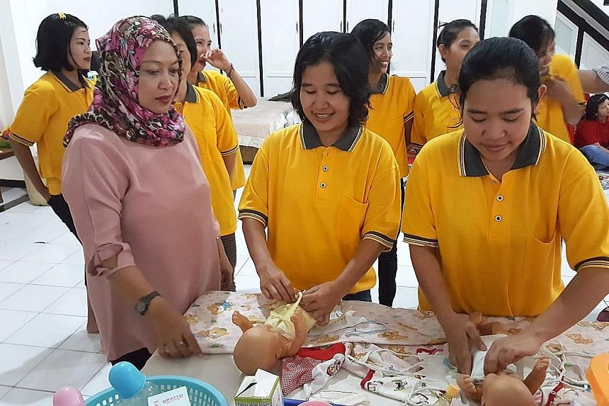 Domestic workers being trained in Jakarta. From next February, workers will also have to learn the language and culture of the country they will be going to.