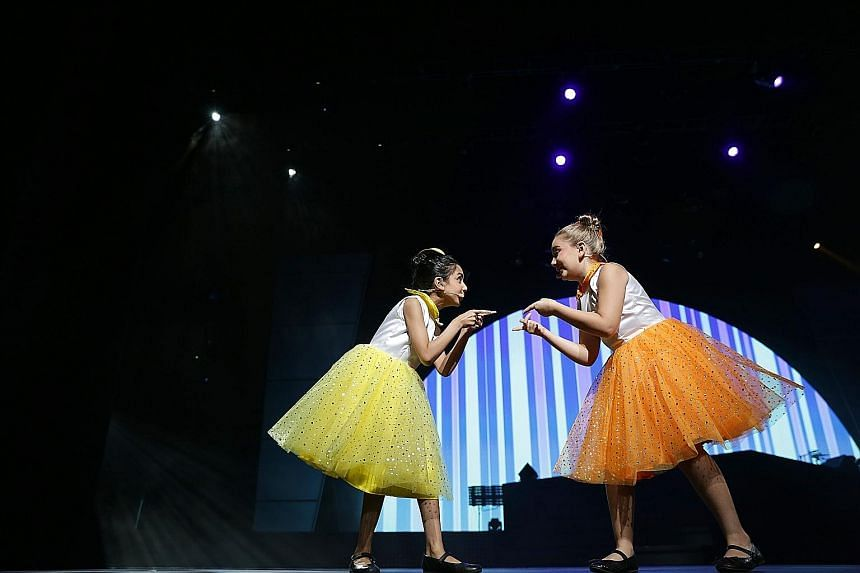 Ria Chhabra (left), seven, and Laura Maurer-Stroh, 10, singing I Don't Need Anything But You from the musical Annie on the final night of the annual ChildAid concert at Resorts World Theatre last night. This 12th edition of ChildAid, organised by The