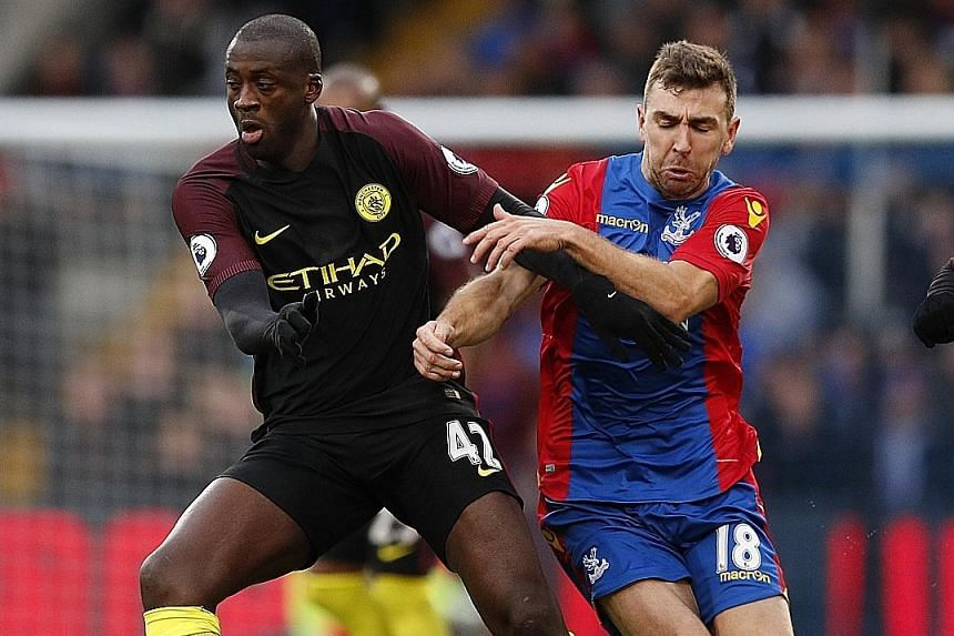 Yaya Toure (left, with James McArthur), in his first English Premier League start for Manchester City this season, scored a double to help Pep Guardiola's men to a 2-1 victory at Crystal Palace. The Ivorian's goals (39th and 83rd) sandwiched Connor W