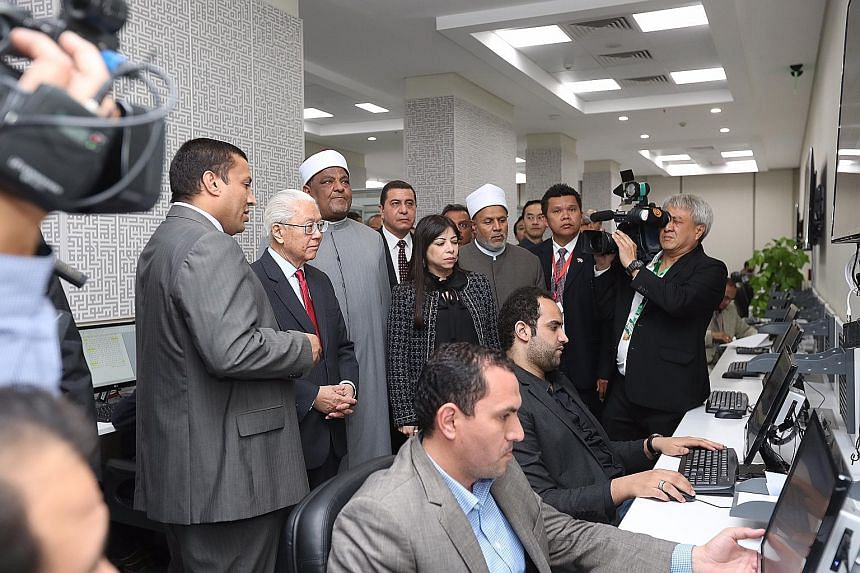President Tony Tan on a tour of Al-Azhar University's Observatory for Foreign Languages in Cairo, Egypt, last month. The observatory monitors extremist ideology online, checking websites and social media in nine languages - including English, Chinese