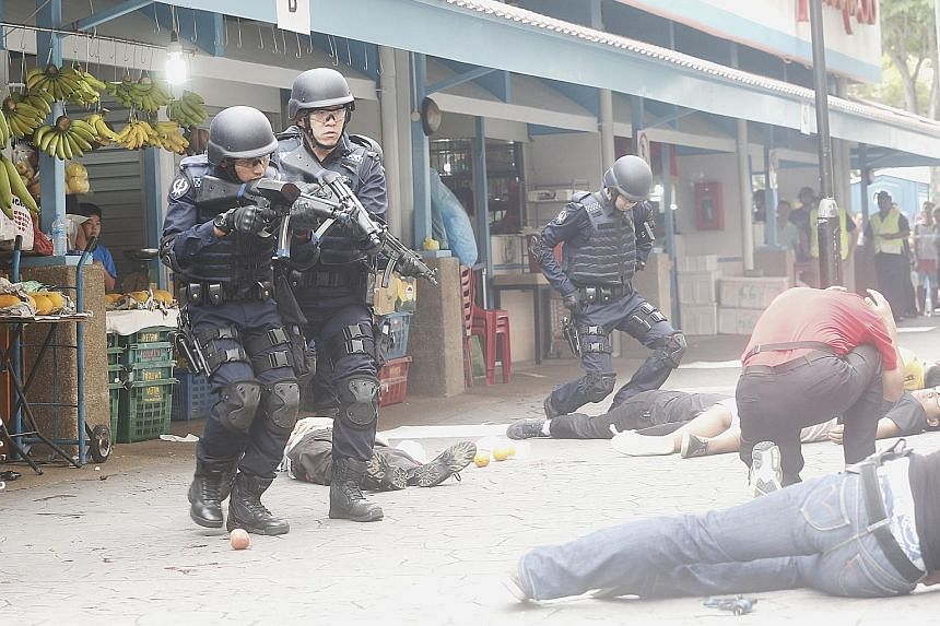 """An anti-terror exercise simulating an attack by a gunman in Bedok last month during Emergency Preparedness Day, part of the """"SGSecure in the Neighbourhood"""" initiative."""