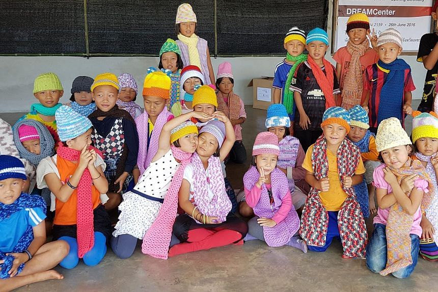 Members of Facebook group Yarns Spree made over 2,500 beanies, scarves, mittens and booties for underprivileged children in northern Thailand for charity Radion International's donation drive.