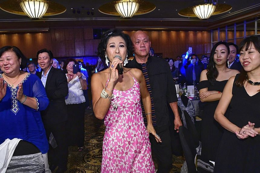 Mandarin pop star Sally Yeh, 55, belting it out at the 30th anniversary dinner of voluntary welfare organisation All Saints Home last night at The Ritz-Carlton, Millenia Singapore. All Saints Home, which runs four nursing homes and two daycare centre