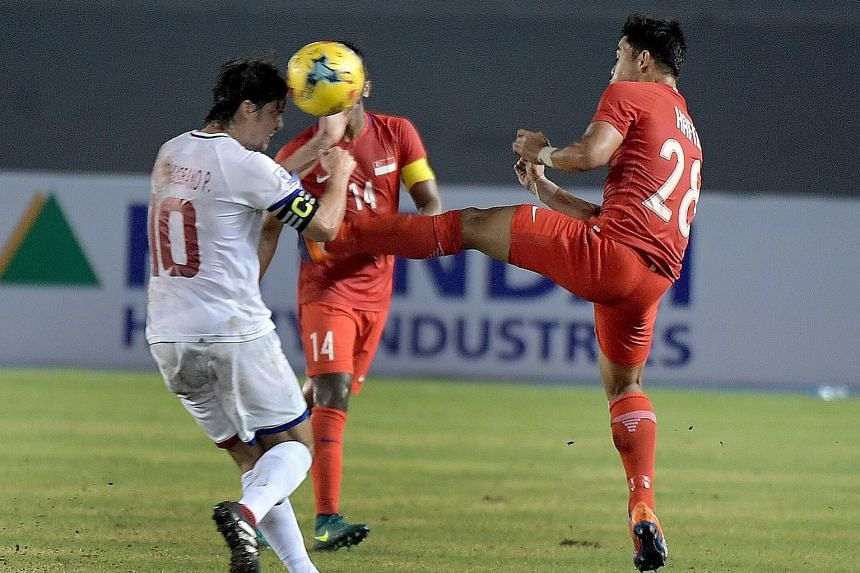 This high studs-up tackle by Hafiz Sujad (right) against Phil Younghusband in the 35th minute earned him a red card in Singapore's 0-0 draw in their AFF Cup opener against the Philippines yesterday.