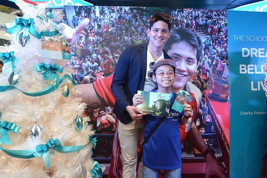 Bryan Liu, 11, along with four other children with life-threatening illnesses from Make-A-Wish Foundation Singapore, had his wish granted when he met Joseph Schooling yesterday at the launch of the Watsons Dream Tree Initiative. It was the University