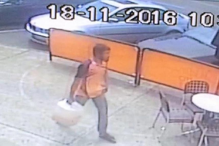 CCTV footage showing the suspect, known in the local Rohingya community as Nur Islam, carrying a large container of liquid moments before Friday's fire at the Commonwealth Bank's branch in Springvale Road in Melbourne.
