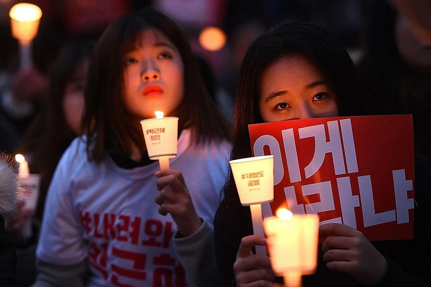 Hundreds of thousands of South Koreans took to the streets of Seoul (left) and other regional capitals last night in the fourth straight weekend of protest against embattled President Park.