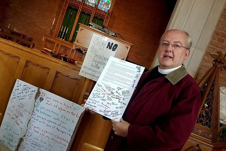 Rev Harvey with messages of support left at his Maryland church after hateful words were found scrawled on the property. A US non-partisan centre that tracks hate crimes and hate groups says that since the Nov 8 presidential election, it has recorded