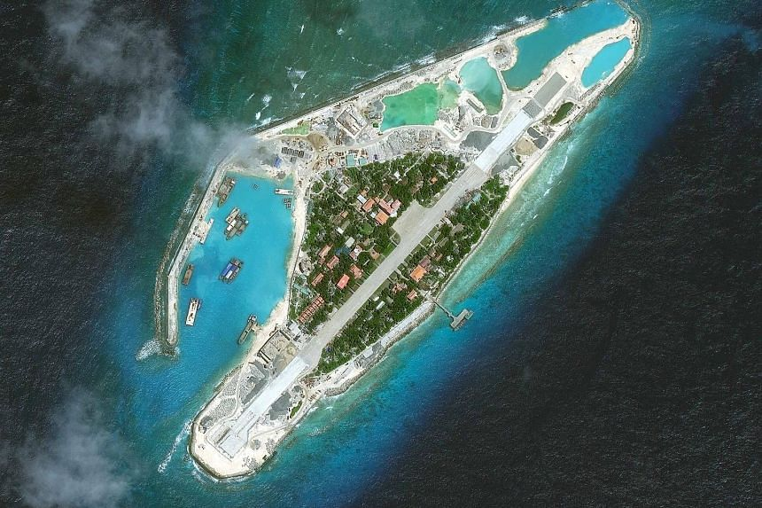 This photo taken earlier this month shows a satellite image of what is believed to be an upgrade by Vietnam to its sole runway on Spratly Island in the South China Sea, in an apparent response to China's building of military facilities on artificial