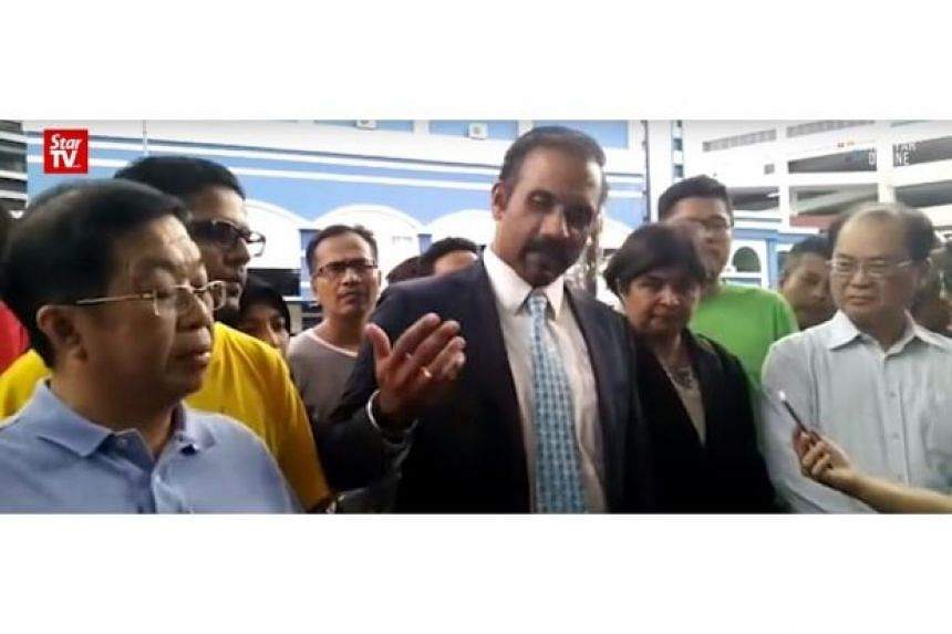 Lawyers Ramkarpal Singh and Datuk Ambiga Sreenevasan speak to media after the release of eight detainees.