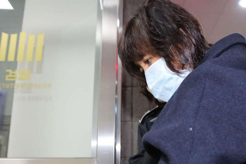 Choi Soon Sil arrives for questioning at a prosecutor's office in Seoul on Nov 1, 2016.