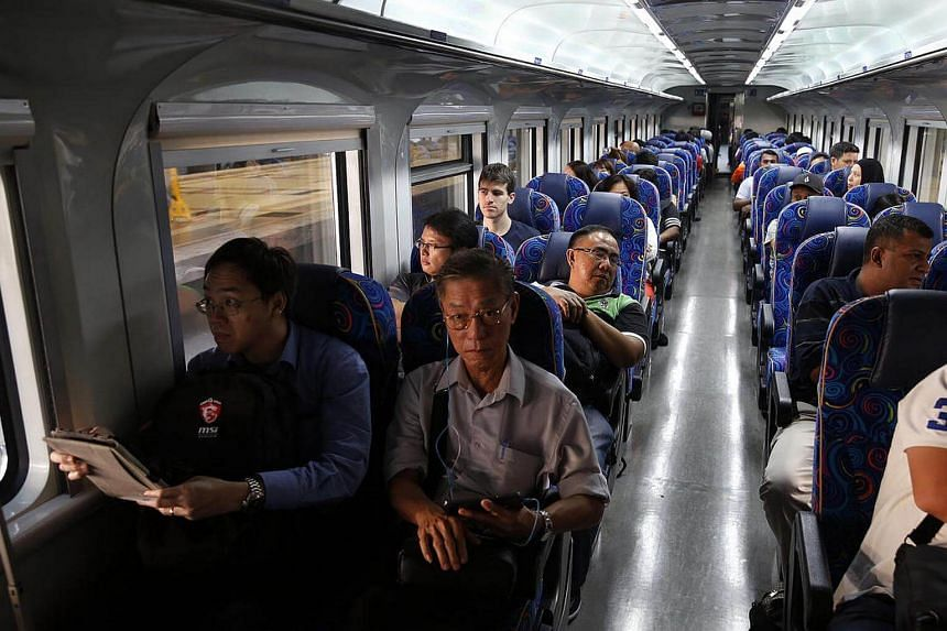 Commuters on board the 8.30am Shuttle Tebrau train from JB Sentral to Woodlands. Tickets for Shuttle Tebrau will no longer be available online from Dec 1.