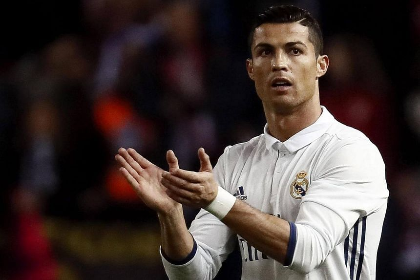 Real Madrid's Cristiano Ronaldo celebrates after scoring his second goal against Atletico Madrid.