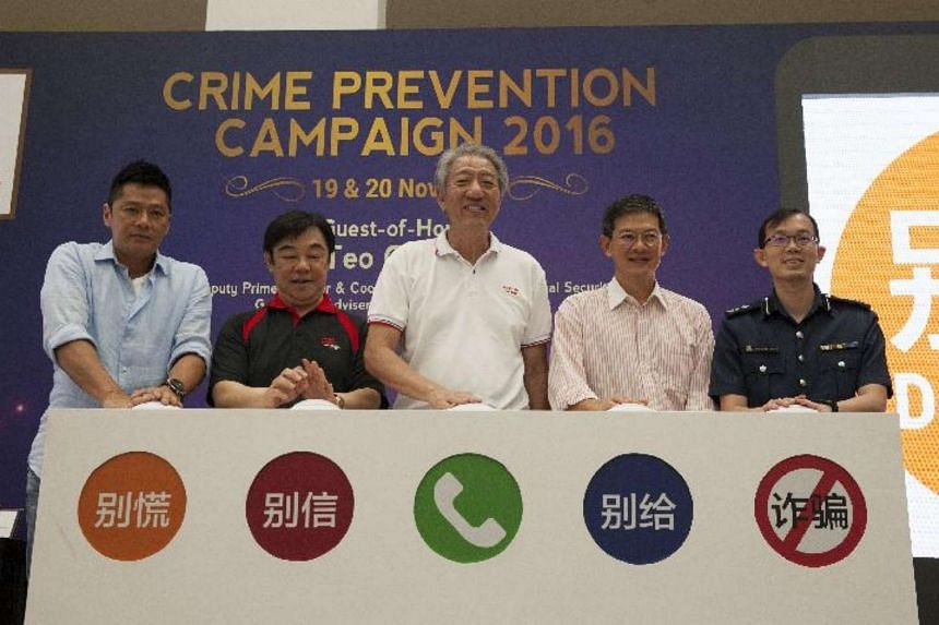 From left: Actor Li Nanxing, National Crime Prevention Council chairman Tan Kian Hoon, Deputy Prime Minister Teo Chee Hean, Commercial Affairs Department director David Chew and Assistant Commissioner of Police Lian Ghim Hua at the launch of the anti