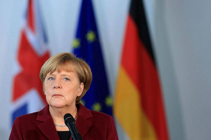 Angela Merkel, Germany's chancellor, looks on during a news conference with UK Prime Minister Theresa May at the Chancellery in Berlin, Germany on Nov 18, 2016.