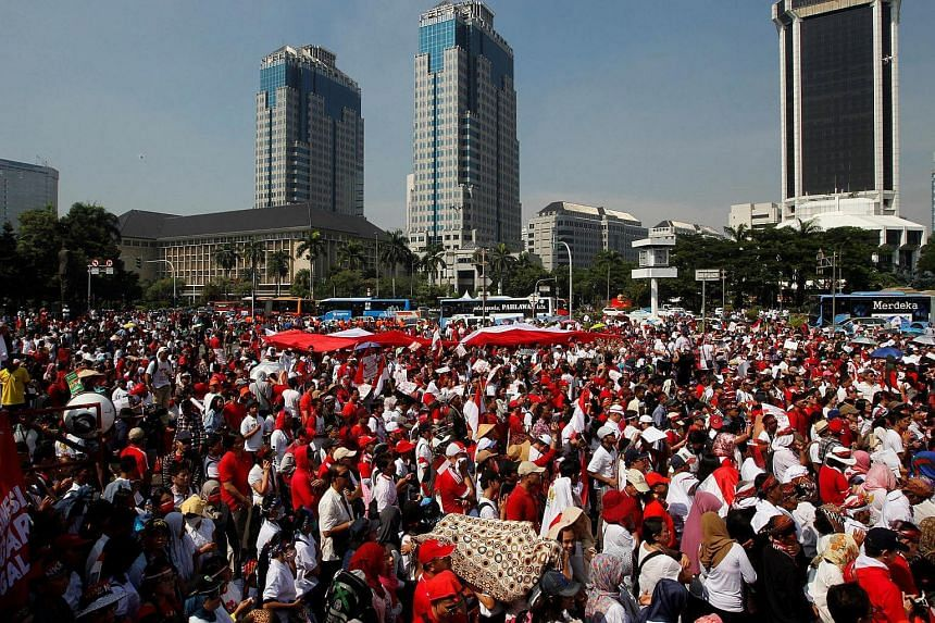 People take part in a rally against what they see as growing racial and religious intolerance in the world's largest Muslim-majority country, in Jakarta, Indonesia on Nov 19, 2016.