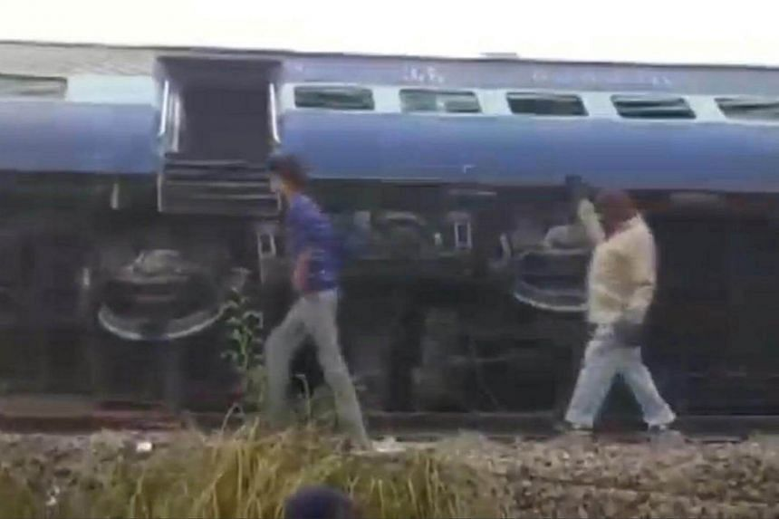 A view of a derailed train in Kanpur, in India's northern state of Uttar Pradesh, in this still image taken from video on Nov 20, 2016.