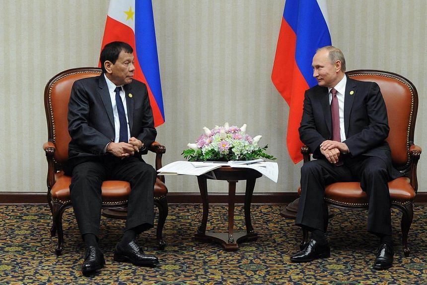 Russian President Vladimir Putin and Filipino President Rodrigo Duterte speak during their meeting in Lima, Peru on Nov 19, 2016.