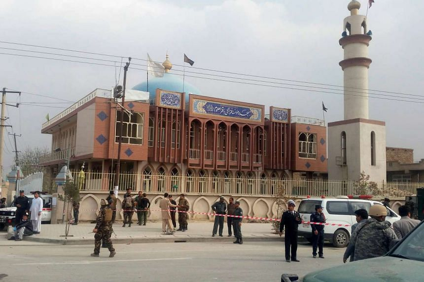 Afghan security forces keep watch in front of a mosque where an explosion happened in Kabul, Afghanistan on Nov 21, 2016.