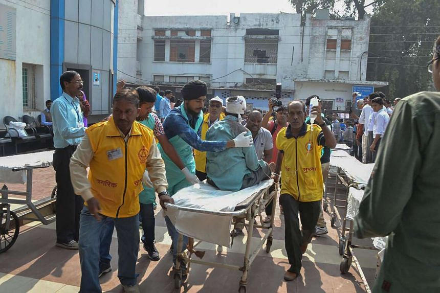 An injured Indian passenger is treated at a hospital in Kanpur on Nov 20, 2016 after a deadly train derailment.