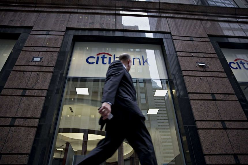 A pedestrian walks past a Citibank branch in Chicago, Illinois, on Oct 5, 2015.