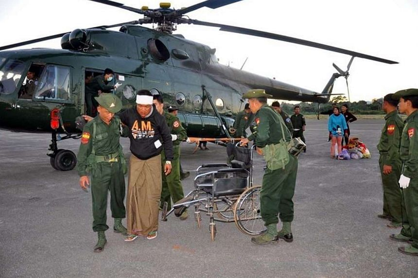 A handout photo provided by Myanmar Military News shows Soldiers helping injured people in Lashio, Shan State, northern Myanmar, on Nov 20, 2016.