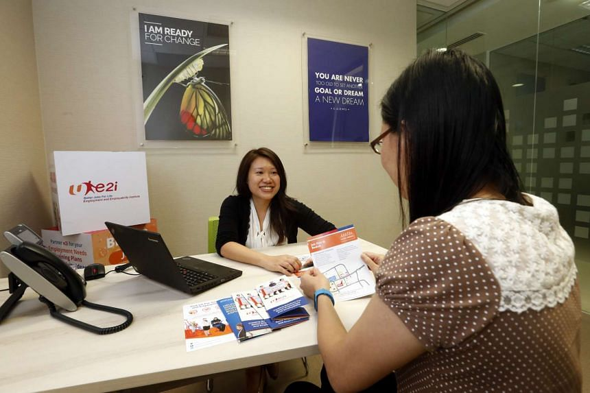 Ms Siew Pei Yinn Regina, Principal Employability Coach of Coaching, e2i central, coaching her client in her new office at Toa Payoh Central.