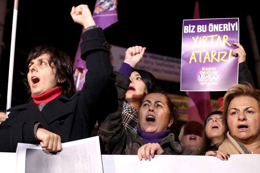 Turkish female protestors shout slogans against the government near Taksim Square, in Istanbul, during a demonstration against a bill which would pardon some people imprisoned for statutory rape on Nov 18, 2016.