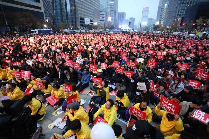 "South Koreans at a ""Park Geun Hye Out"" rally against the South Korean President in Seoul on Nov 19, 2016."