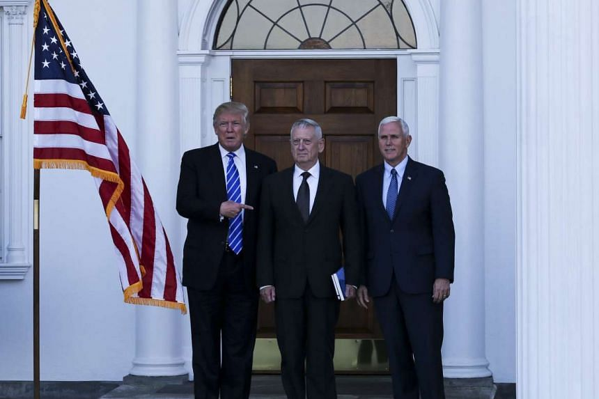 US President-elect Donald Trump (left) and Vice President-elect Mike Pence (right) pose with retired United States Marine Corps general James Mattis (centre) at the clubhouse of Trump International Golf Club, in Bedminster Township, New Jersey, USA,