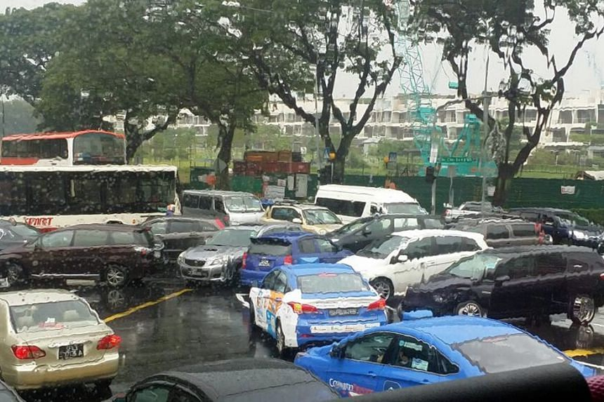 Motorists and commuters were caught in a jam at the junction of Yio Chu Kang Road and Ang Mo Kio Avenue 5 yesterday as the traffic lights stopped working during a heavy downpour.