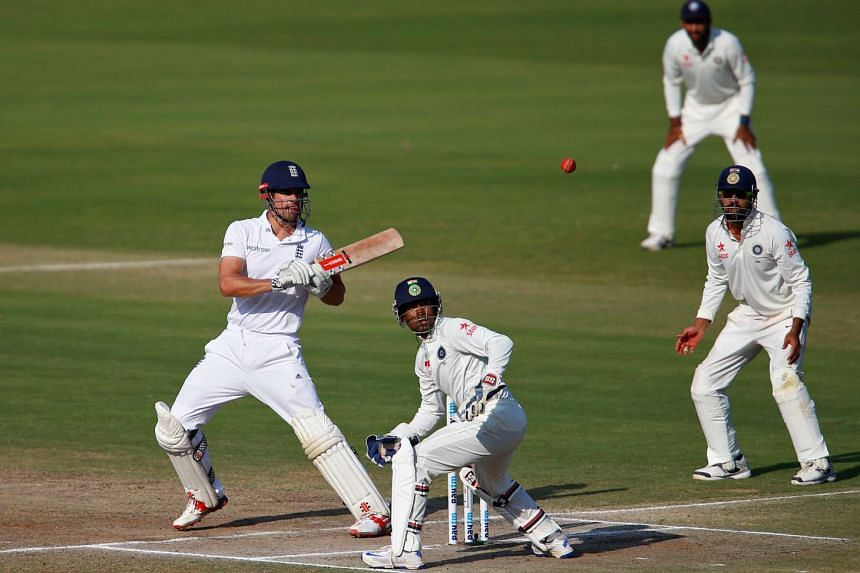 Alastair Cook plays a shot at a Second Test cricket match between India and England.