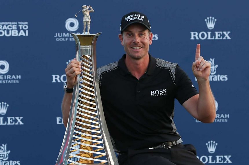 Henrik Stenson of Sweden poses with his trophy after winning the Race to Dubai at the end of the DP World Tour Championship at Jumeirah Golf Estates in Dubai, on Nov 20, 2016.