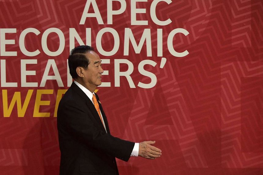 Taiwan's representative James Soong reaches out to shake hands at the Lima Convention Centre for the APEC Leaders' Retreat on the last day of the Asia-Pacific Economic Cooperation (APEC) Summit in Lima on Nov 20, 2016.