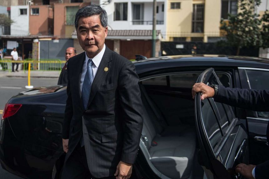 Hong Kong's Chief Executive Leung Chun-ying (C) arrives at the Lima Convention Centre to attend the APEC CEO Summit, part of the broader Asia-Pacific Economic Cooperation Summit in Lima on Nov 19, 2016.