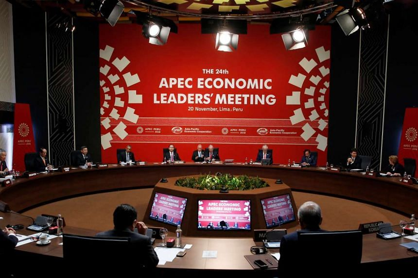 Attendees taking their seats for the Apec Economic Leaders' Meeting in Lima, Peru, on Nov 20, 2016.