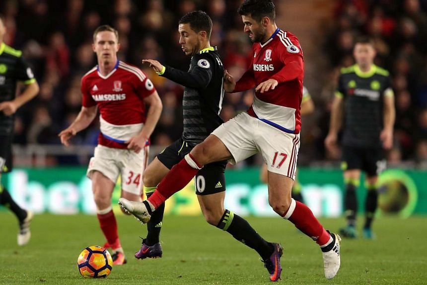 Middlesbrough's Antonio Barragan (right) challenges Chelsea's Eden Hazard during the English Premier League soccer match between Middlesbrough and Chelsea at the Riverside stadium, Middlesbrough, Britain, on Nov 20, 2016.