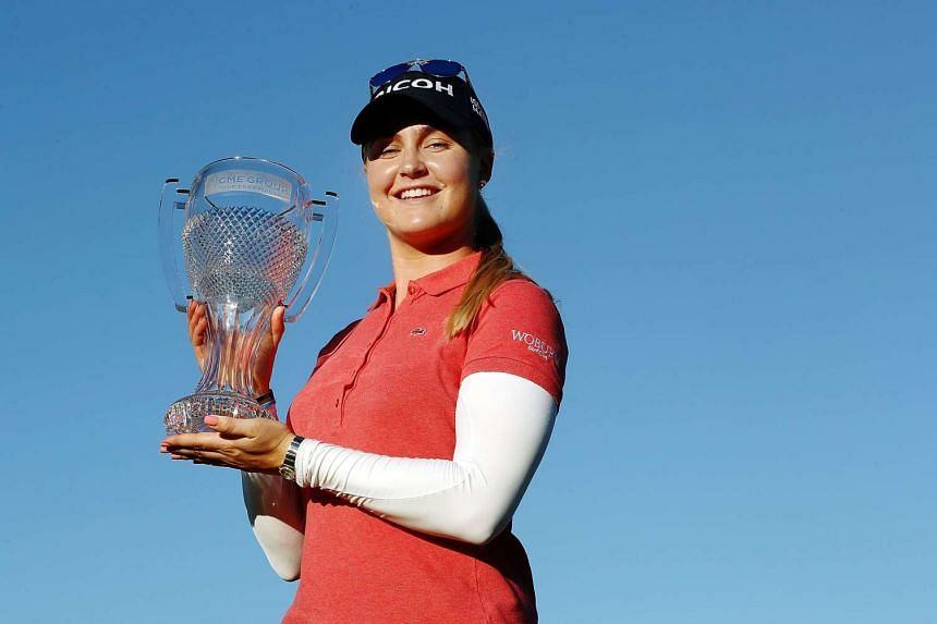 Charley Hull of England poses with the CME Tour Championship trophy during the final round of the CME Group Tour Championship at Tiburon Golf Club on Nov 20, 2016 in Naples, Florida.