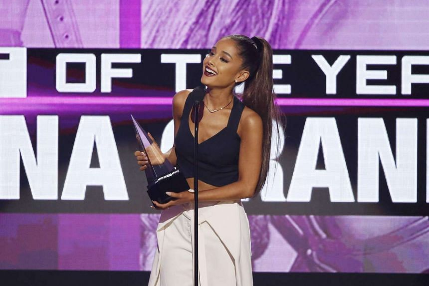 Ariana Grande accepts the award for artist of the year at the 2016 American Music Awards in Los Angeles, California on Nov 20, 2016.