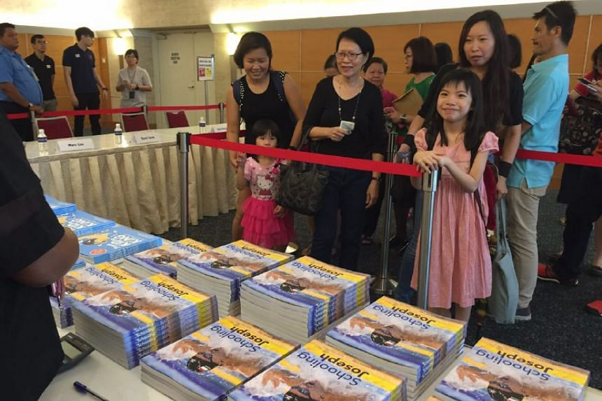 The first wave of fans who arrived at SPH to get their copies of Joseph Schooling's two books, published by Straits Times Press.