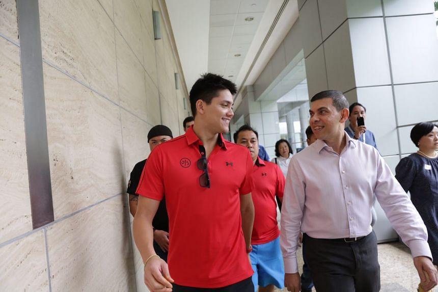 Joseph Schooling arrives at the book signing session at Singapore Press Holdings.