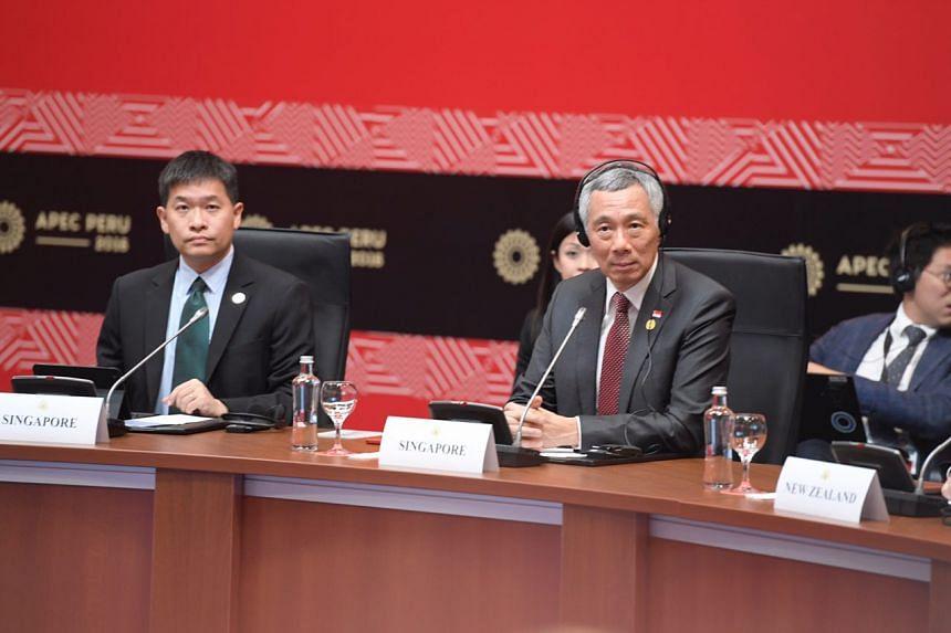 PM Lee and Deputy Secretary (Trade) MTI Luke Goh (left), at the TPP Leaders meeting in Lima, Peru on Nov 19, 2016.
