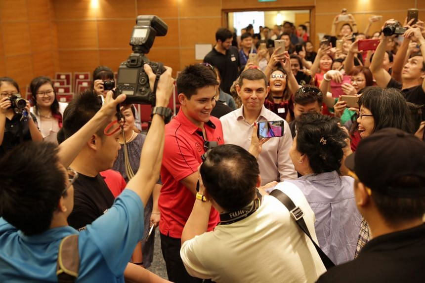 Fans engaging with Joseph Schooling.