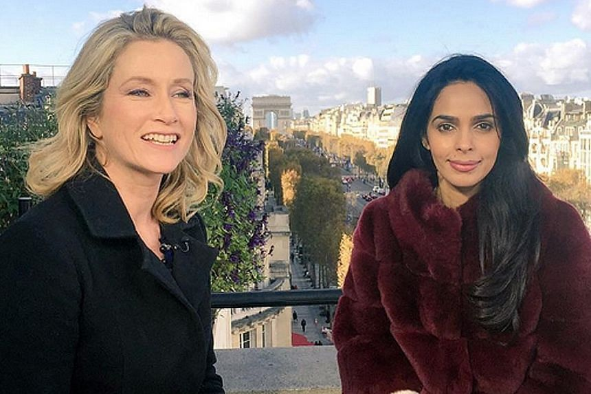 Mallika Sherawat (far right) posted on Instagram a photo of herself with a CNN journalist who interviewed her about the assault.
